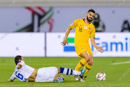 Aziz Behich of Australia (R) fights for the ball with Davronbek Khashimov of Uzbekistan (L) during the Round of 16 match