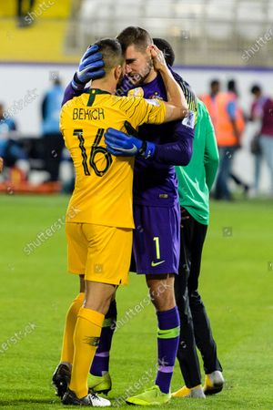 Goalkeeper Mathew Ryan of Australia (R) and Aziz Behich of Australia (L) celebrates following their sides win after a penalty shoot-out in the Round of 16 match