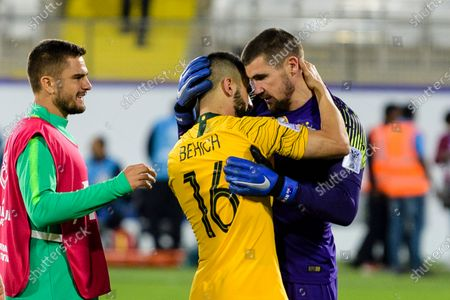 Goalkeeper Mathew Ryan of Australia (R) and Aziz Behich of Australia (C) celebrates following their sides win after a penalty shoot-out in the Round of 16 match