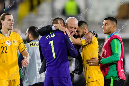 Australia Head Coach Graham Arnold (C) celebrates with Goalkeeper Mathew Ryan of Australia (L2) and Aziz Behich of Australia (R2) following their sides win after a penalty shoot-out in the Round of 16 match