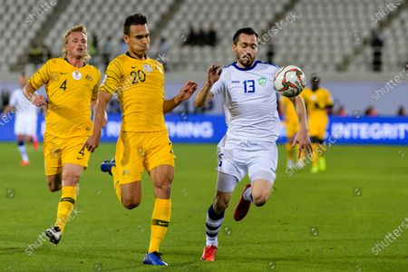 Oleg Zoteev of Uzbekistan (R) fights for the ball with Trent Sainsbury of Australia (L2) during the Round of 16 match