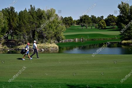 Jason Kokrak, right, walks along the fairway with his caddie David Robinson during the final round of the CJ Cup golf tournament at Shadow Creek Golf Course, in North Las Vegas
