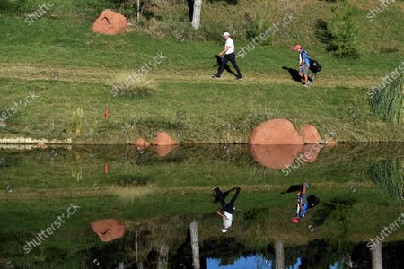 Stock Picture of Jason Kokrak, left, walks along the fairway with his caddie David Robinson during the final round of the CJ Cup golf tournament at Shadow Creek Golf Course, in North Las Vegas