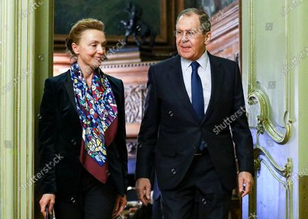 In this photo released by the Russian Foreign Ministry Press Service, Russian Foreign Minister Sergey Lavrov, right, and Secretary General of the Council of Europe Marija Pejcinovic Buric enter a hall for their joint news conference following their talks in Moscow, Russia