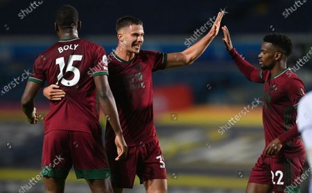 Leander Dendoncker (C) Willy Boly (L) and Nelson Semedo (R) of Wolverhampton celebrate wining their game at the end of the English Premier League match between Leeds United and Wolverhampton Wanderers in Leeds, Britain, 19 October 2020.