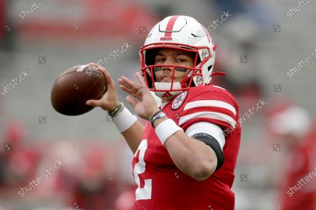 Nebraska quarterback Adrian Martinez warms up before an NCAA college football game against Iowa in Lincoln, Neb., . Martinez turned back a challenge from Luke McCaffrey to win the starting quarterback's job for Nebraska's opener at No. 5 Ohio State, coach Scott Frost announced Monday, Oct. 19, 2020