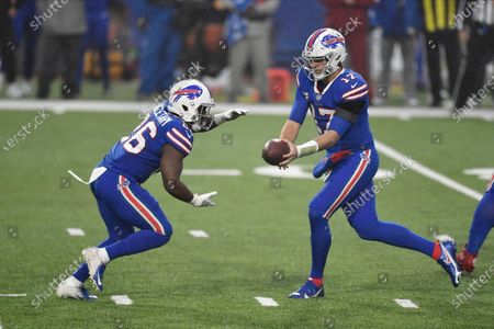 Buffalo Bills quarterback Josh Allen, right, hands off to Devin Singletary during the first half of an NFL football game against the Kansas City Chiefs, in Orchard Park, N.Y