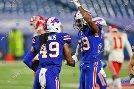 Buffalo Bills' Tremaine Edmunds, left, celebrates a fumble recovery with Josh Norman during the second half of an NFL football game against the Kansas City Chiefs, in Orchard Park, N.Y