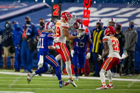 Kansas City Chiefs free safety Daniel Sorensen (49) makes an interception in the final minutes of the game against the Buffalo Bills during the second half of an NFL football game, in Orchard Park, N.Y