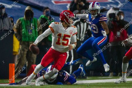 Stock Image of Kansas City Chiefs quarterback Patrick Mahomes (15) runs with the ball against Buffalo Bills cornerback Josh Norman (29) during the second half of an NFL football game, in Orchard Park, N.Y