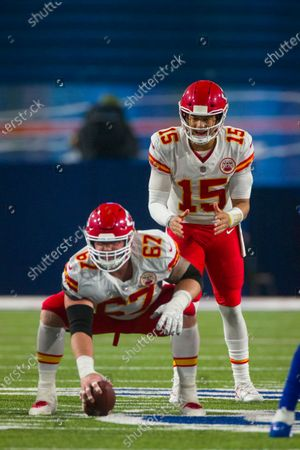 Kansas City Chiefs quarterback Patrick Mahomes (15) readies behind center Daniel Kilgore (67) during the second half of an NFL football game against the Buffalo Bills, in Orchard Park, N.Y