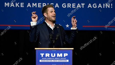 Eric Trump, son of President, Donald Trump, speaks with supporters at a campaign rally, in Manchester, N.H