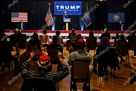 Eric Trump, son of President, Donald Trump, addresses a gathering of supporters at a campaign rally, in Manchester, N.H