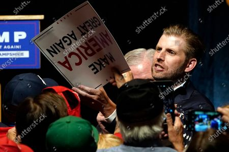 Eric Trump, son of President, Donald Trump, is greeted by supporters at a campaign rally, in Manchester, N.H