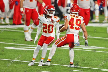 Stock Photo of Kansas City Chiefs' Daniel Sorensen, right, celebrates his touchdown with Antonio Hamilton during the second half of an NFL football game against the Buffalo Bills, in Orchard Park, N.Y. The Chiefs defeated the Bills 26-17