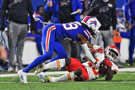 Buffalo Bills' Josh Norman, left, brings down Kansas City Chiefs' Tyreek Hill during the second half of an NFL football game, in Orchard Park, N.Y