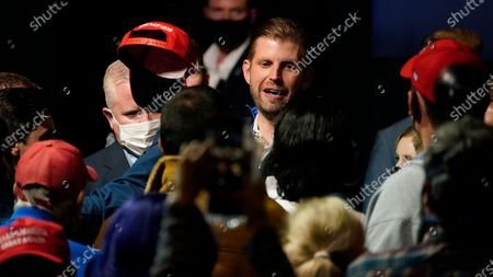 Eric Trump, son of President, Donald Trump, is greeted by supporters at a campaign rally, in Manchester, New Hampshire