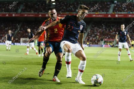 Josip Pivaric of Croatia (R) fights for the ball with Daniel Carvajal of Spain (L) during their UEFA Nations League 2018-19 match between Spain and Croatia at Manuel Martínez Valero