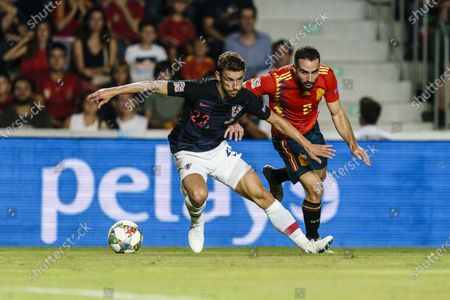 Daniel Carvajal of Spain (R) in action against Josip Pivaric of Croatia (L) during their UEFA Nations League 2018-19 match between Spain and Croatia at Manuel Martínez Valero