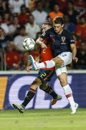 Daniel Carvajal of Spain (L) in action against Josip Pivaric of Croatia (R) during their UEFA Nations League 2018-19 match between Spain and Croatia at Manuel Martínez Valero