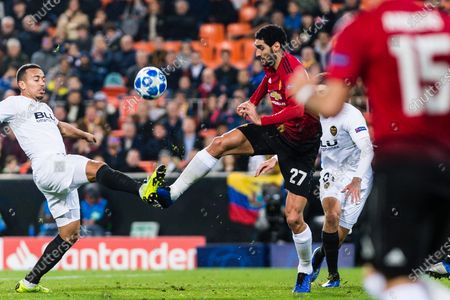 Marouane Fellaini of Manchester United (R) battles for the ball with Ruben Nunes Vezo of Valencia CF (L) during the UEFA Champions League 2018-19 match between Valencia CF and Manchester United at Estadio de Mestalla