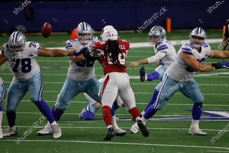 Arizona Cardinals' De'Vondre Campbell (59) rushes as Dallas Cowboys place kicker Greg Zuerlein (2) attempts a field goal in the second half of an NFL football game in Arlington, Texas, . The attempt was no good