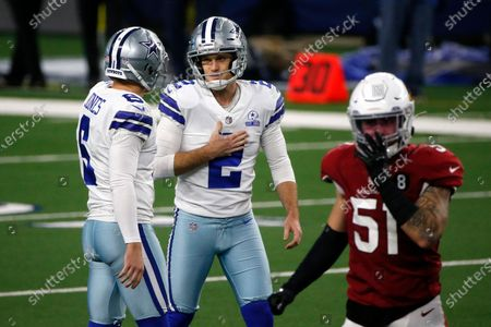 Dallas Cowboys' Chris Jones (6) and Greg Zuerlein (2) talk after an unsuccessful field goal attempt by Zuerlein as Arizona Cardinals' Tanner Vallejo (51) walks away in the second half of an NFL football game in Arlington, Texas
