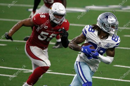 Arizona Cardinals linebacker Jordan Hicks (58) gives chase as Dallas Cowboys wide receiver CeeDee Lamb (88) gains yardage after a catch for a first down in the second half of an NFL football game in Arlington, Texas