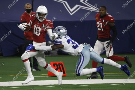 Arizona Cardinals wide receiver DeAndre Hopkins (10) is brought down after a long gain on a catch by Dallas Cowboys' Donovan Wilson (37) in the second half of an NFL football game in Arlington, Texas