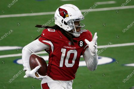 Arizona Cardinals wide receiver DeAndre Hopkins (10) gains yardage after catching a pass in the second half of an NFL football game against the Dallas Cowboys in Arlington, Texas