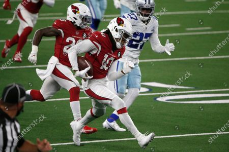 Arizona Cardinals' DeAndre Hopkins (10) carries the ball for a long gain after catching a pass as Dallas Cowboys' Trevon Diggs (27) gives chase in the second half of an NFL football game in Arlington, Texas