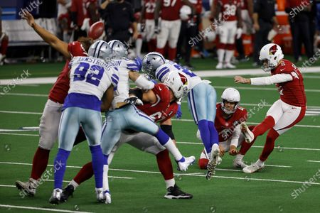 Arizona Cardinals' Andy Lee, second from right, holds as Zane Gonzalez (5) kicks a field goal in the second half of an NFL football game against the Dallas Cowboys in Arlington, Texas
