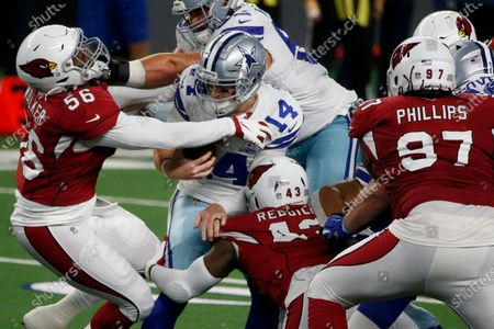 Arizona Cardinals' Reggie Walker (56), Haason Reddick (43) and Jordan Phillips (97) combine to sack Dallas Cowboys' Andy Dalton (14) in the second half of an NFL football game in Arlington, Texas