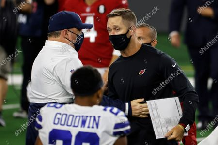 Dallas Cowboys head coach Mike McCarthy, center left, and Arizona Cardinals head coach Kliff Kingsbury, center right, greet each other after their NFL football game in Arlington, Texas