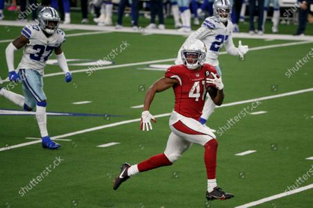 Arizona Cardinals running back Kenyan Drake (41) sprints to the end zone for a touchdown as Dallas Cowboys' Donovan Wilson (37) and Trevon Diggs (27) give chase in the second half of an NFL football game in Arlington, Texas