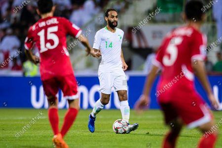 Abdullah Otayf of Saudi Arabia (C) in action during the AFC Asian Cup UAE 2019 Group C match between Saudi Arabia (KSA) and North Korea (PRK) at Rashid Stadium