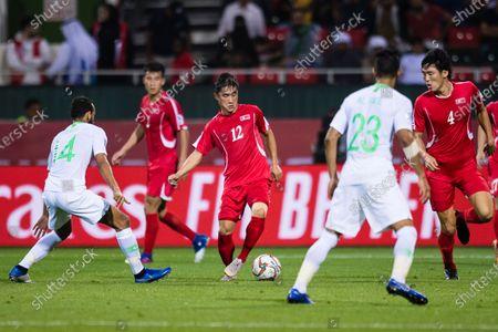 Kim Kyong Hun of North Korea (C) in action against Abdullah Otayf of Saudi Arabia (L) during the AFC Asian Cup UAE 2019 Group C match between Saudi Arabia (KSA) and North Korea (PRK) at Rashid Stadium