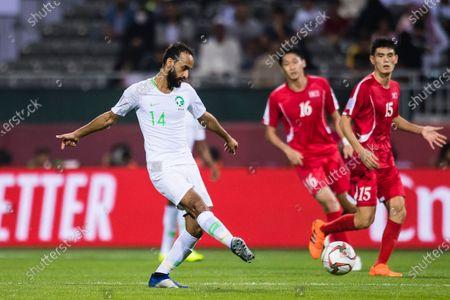 Abdullah Otayf of Saudi Arabia (L) in action during the AFC Asian Cup UAE 2019 Group C match between Saudi Arabia (KSA) and North Korea (PRK) at Rashid Stadium