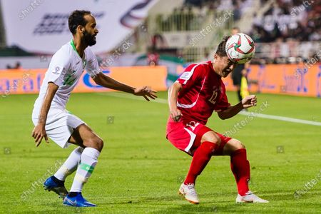 Kim Kyong Hun of North Korea (R) competes for the ball with Abdullah Otayf of Saudi Arabia (L) during the AFC Asian Cup UAE 2019 Group C match between Saudi Arabia (KSA) and North Korea (PRK) at Rashid Stadium