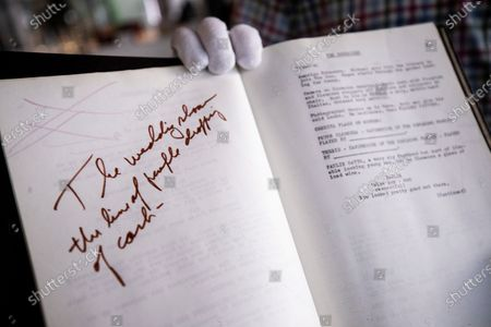 Stock Photo of A signed by the cast 1970 early draft annotated script from 'The Godfather' is shown by an employee and put for auction at Julien's Auctions in Beverly Hills, California, USA, 19 October 2020. The auction will be held on 24 October 2020.
