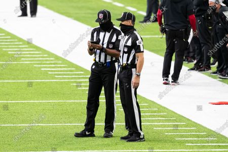 Back judge Greg Meyer (78) talks to line judge Tim Podraza (47) in the fourth quarter during an NFL football game between the Atlanta Falcons and Minnesota Vikings, in Minneapolis. The Falcons defeated the Vikings 40-23