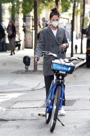 Katie Holmes rides a Citi bike in SoHo.