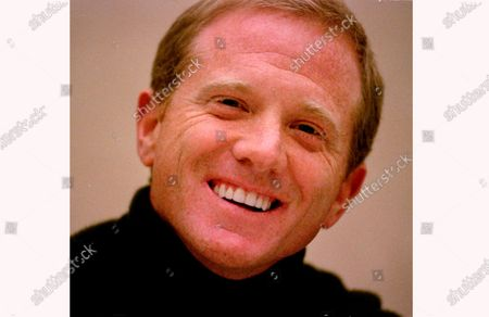 """Stock Photo of James Redford, son of actor Robert Redford, laughs during a press conference on Nov. 18, 1998. Redford, a filmmaker, activist, and son of actor Robert Redford, has died. He was 58. Robert Redford's publicist, Cindi Berger, said in a statement, that the 84-year-old father is mourning with his family during this """"difficult time"""