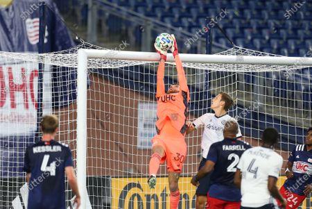Foxborough, MA, USA; New England Revolution goalkeeper Matt Turner (30) makes a save during an MLS match between Philadelphia Union and New England Revolution at Gillette Stadium