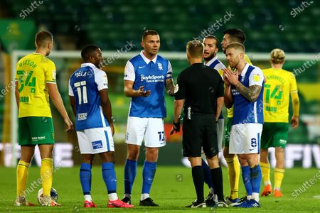 Adam Clayton of Birmingham City and team mates appeal to the referee as he is shown a second yellow card and red for a foul on Cantwell; Carrow Road, Norwich, Norfolk, England, English Football League Championship Football, Norwich versus Birmingham City.