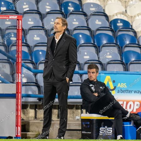 Derby Manager Philip Cocu looks up at the display screen in added time; 20th October 2020 The John Smiths Stadium, Huddersfield, Yorkshire, England; English Football League Championship Football, Huddersfield Town versus Derby County.