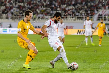 Stock Photo of Abdul Malek Alanizan of Syria (R) fights for the ball with Robbie Kruse of Australia (L) during the AFC Asian Cup UAE 2019 Group B match between Australia (AUS) and Syria (SYR) at Khalifa Bin Zayed Stadium on 15 January 2019 in Al Ain, United Arab Emirates. Photo by Marcio Rodrigo Machado / Power Sport Images