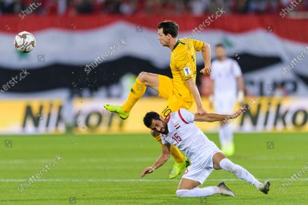 Stock Picture of Robbie Kruse of Australia (L) competes for the ball with Abdul Malek Alanizan of Syria (R) during the AFC Asian Cup UAE 2019 Group B match between Australia (AUS) and Syria (SYR) at Khalifa Bin Zayed Stadium on 15 January 2019 in Al Ain, United Arab Emirates. Photo by Marcio Rodrigo Machado / Power Sport Images