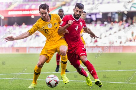 Robbie Kruse of Australia (L) battles for the ball with Baha Abdelrahman of Jordan (R) during the AFC Asian Cup UAE 2019 Group B match between Australia (AUS) and Jordan (JOR) at Hazza Bin Zayed Stadium on 06 January 2019 in Al Ain, United Arab Emirates. Photo by Marcio Rodrigo Machado / Power Sport Images
