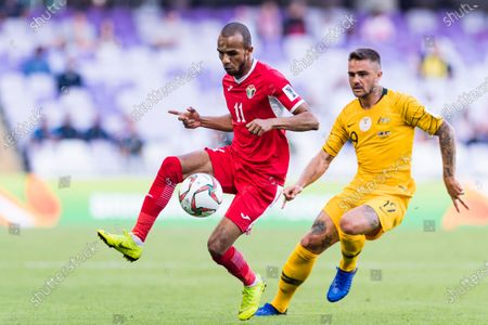 Yaseen Mahmoud Bakheet of Jordan (L) is followed by Josh Risdon of Australia (R) during the AFC Asian Cup UAE 2019 Group B match between Australia (AUS) and Jordan (JOR) at Hazza Bin Zayed Stadium on 06 January 2019 in Al Ain, United Arab Emirates. Photo by Marcio Rodrigo Machado / Power Sport Images